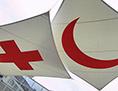 Die Logos der internationalen Rotkreuz- und Rothalbmond-Bewegung in Genf.