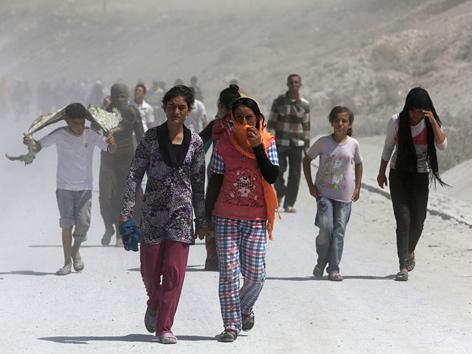 Jesiden auf der Flucht vor Terrormiliz IS