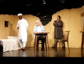 "Szene aus dem Theaterstück ""The Invisible Hand"""