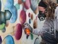 Graffiti-Kunst am CERN, die Atome zeigt