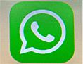Das Logo von WhatsApp auf dem Display eines Handys