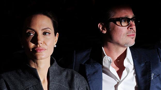Angelina Jolie und Brad Pitt schauen nachdenklich
