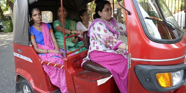 Indian woman rickshaw driver
