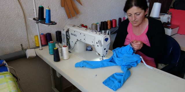 A woman benefitted from a work creation scheme in Kosovo