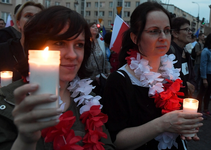 People hold candles as they take part in demonstration in front of the Polish Supreme Court on July 23, 2017