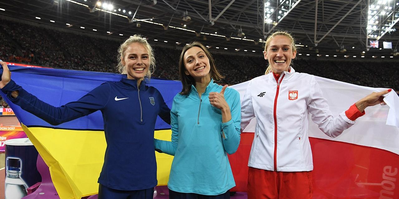 Maria Lasitskene, Yuliia Levchenko und Kamila Licwinko feiern ihre Hochsprung WM-Medaillenplätze