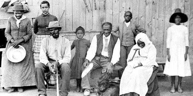 Harriet Tubman mit befreiten Sklaven