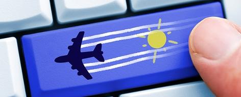 Reise/Urlaub online buchen: Computertaste mit Flugzeug
