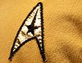 Logo auf der Uniform des Kapitäns der Enterprise