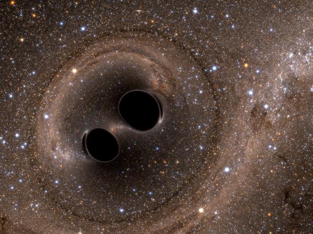 Künstlerische Darstellung: Zwei schwarze Löcher kollidieren