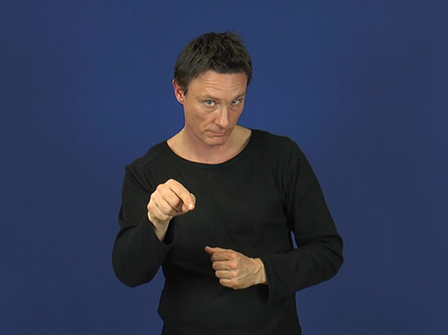 Ein Mann erzählt in Gebärdensprache