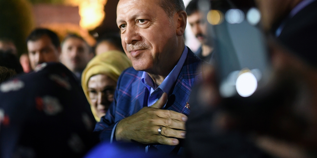 Turkish president Recep Tayyip Erdogan, flanked by his wife Emine Erdogan, acknowledges supporters, following the results of a nationwide referendum.