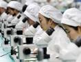 Arbeiterinnen in chinesischer High-Tech-Fabrik