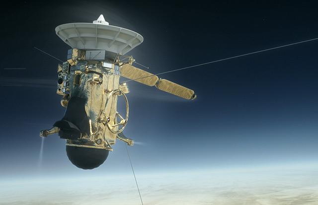 """Künstlerische Darstellung von """"Cassini"""" über dem Saturn"""