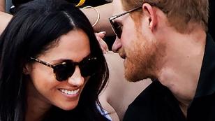 Prinz Harry und Meghan Markle tuscheln