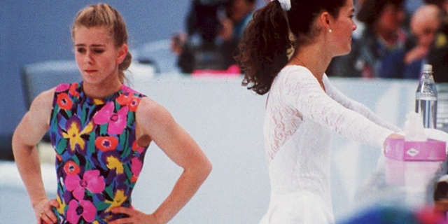 US figure skaters Tonya Harding (L) and Nancy Kerrigan avoid each other during a training session 17 February in Hamar, Norway, during the Winter Olympics.