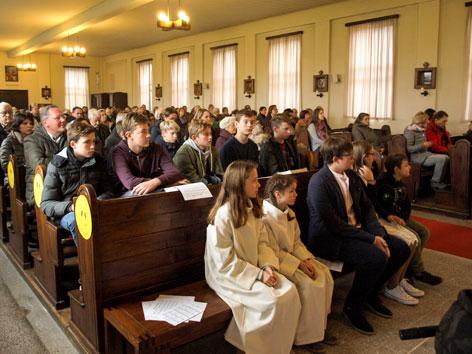 Kirchengemeinde beim Gottesdienst