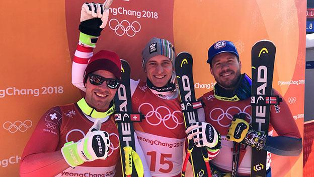 Matthias Mayer als Sieger im Super-G, zusammen mit den Silber- und Bronzemedaillengewinnern Beat Feuz und Kjetil Jansrud