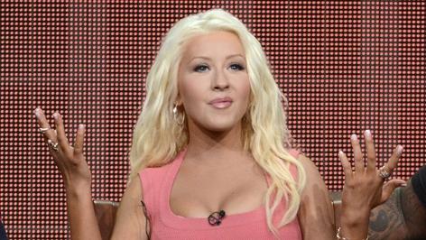 Christina Aguilera in einem rosafarbenen Kleid