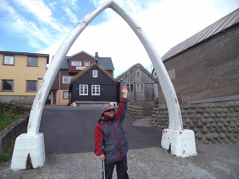 Tony at a whalebone arch, in Nólsoy, Faroe Islands