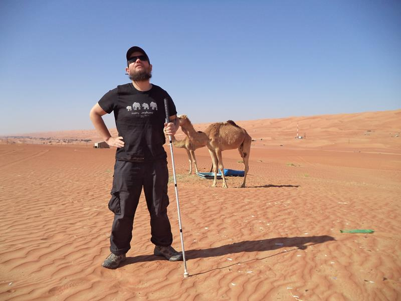 Tony Giles with two camels in Oman
