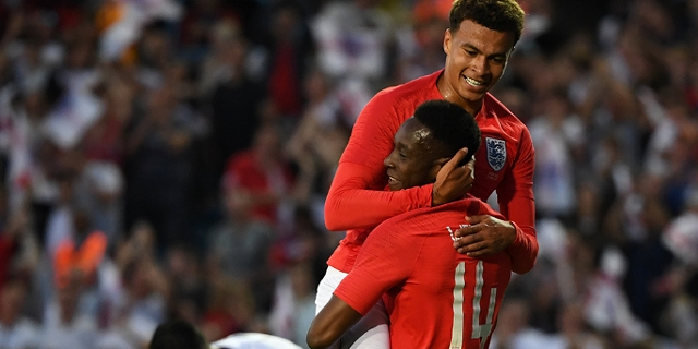 England's striker Danny Welbeck celebrates with England's midfielder Dele Alli (up) after scoring their second goal during the International friendly football match between England and Costa Rica