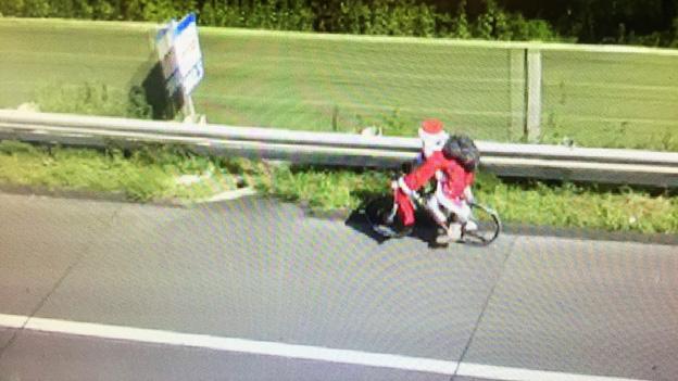 Weihnachtsmann auf einem Rad