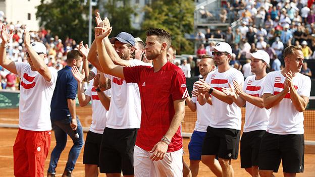 Dominic Thiem und das österreichische Davis-Cup-Team jubeln.