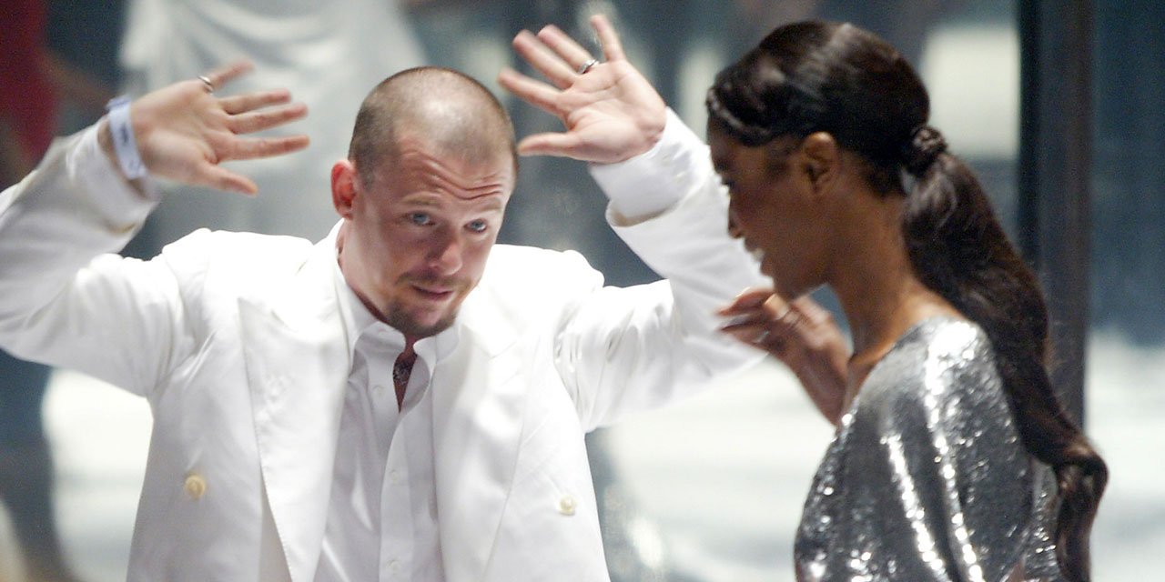 Designer Alexander McQueen is greeted by model Naomi Campbell after the 'Black' fashion show in London 03 June, 2004