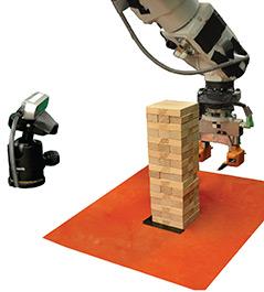 Stapel: Roboter beim Jenga-Spiel