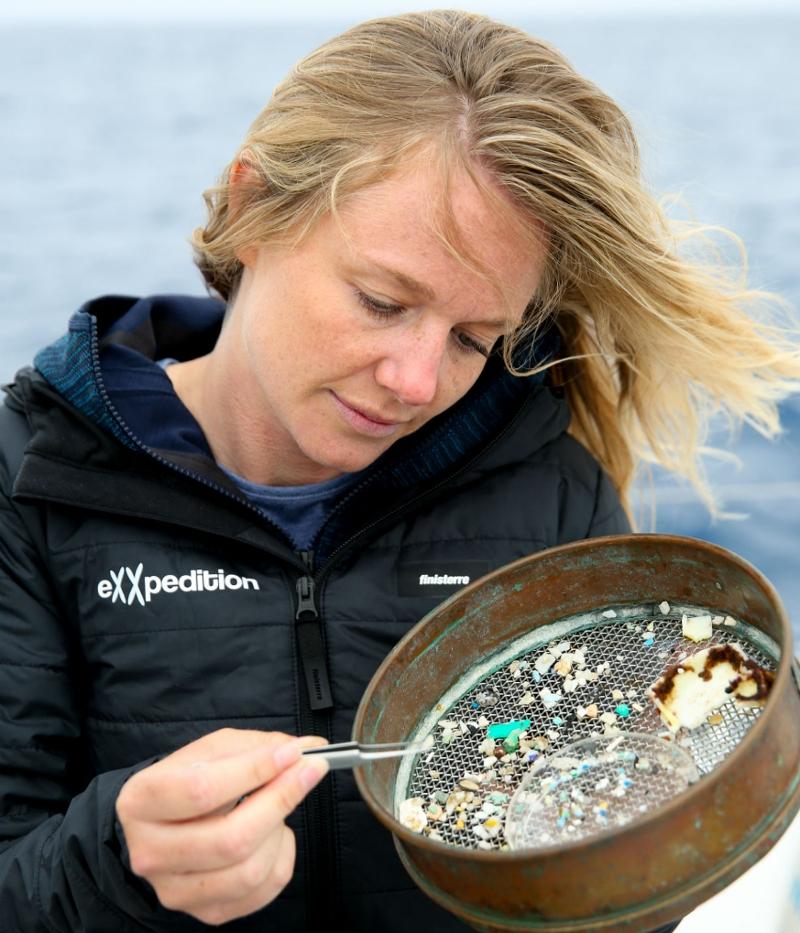 Emily examining plastic