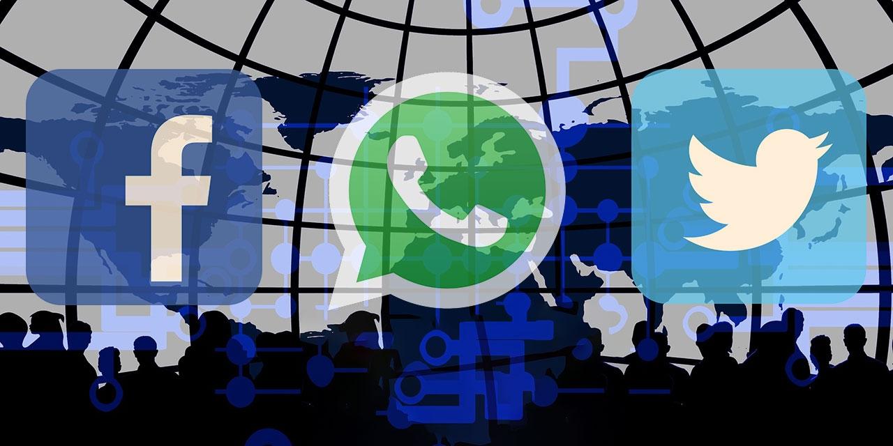Whatsapp, Facebook und Twitter Logo, vor schemenhaften Personen