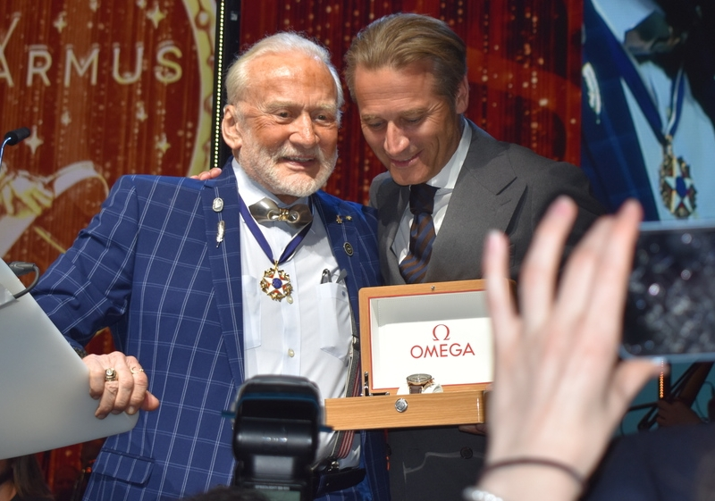 Buzz Aldrin and the guy who appears with watches