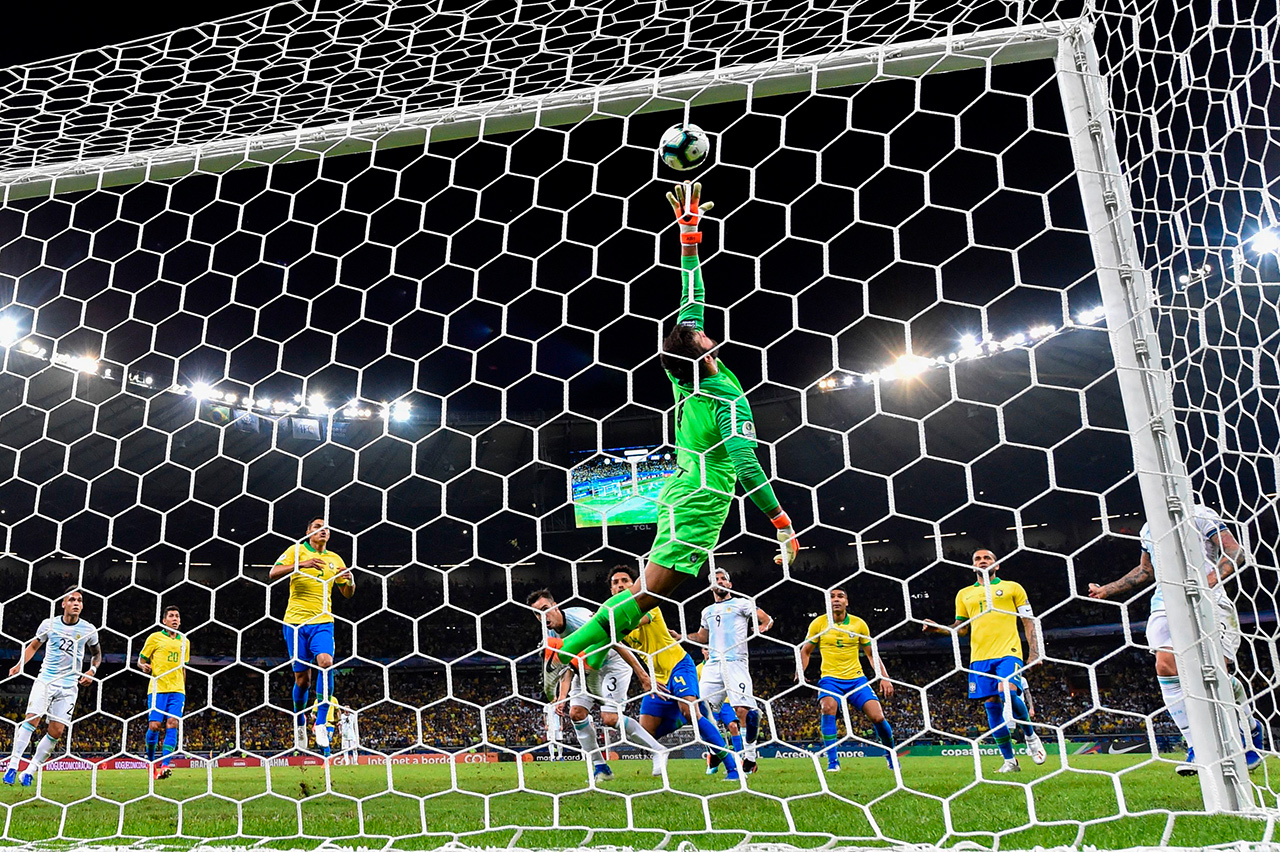 Brazil's goalkeeper Alisson stretches for the ball during the Copa America football tournament semi-final match against Argentina