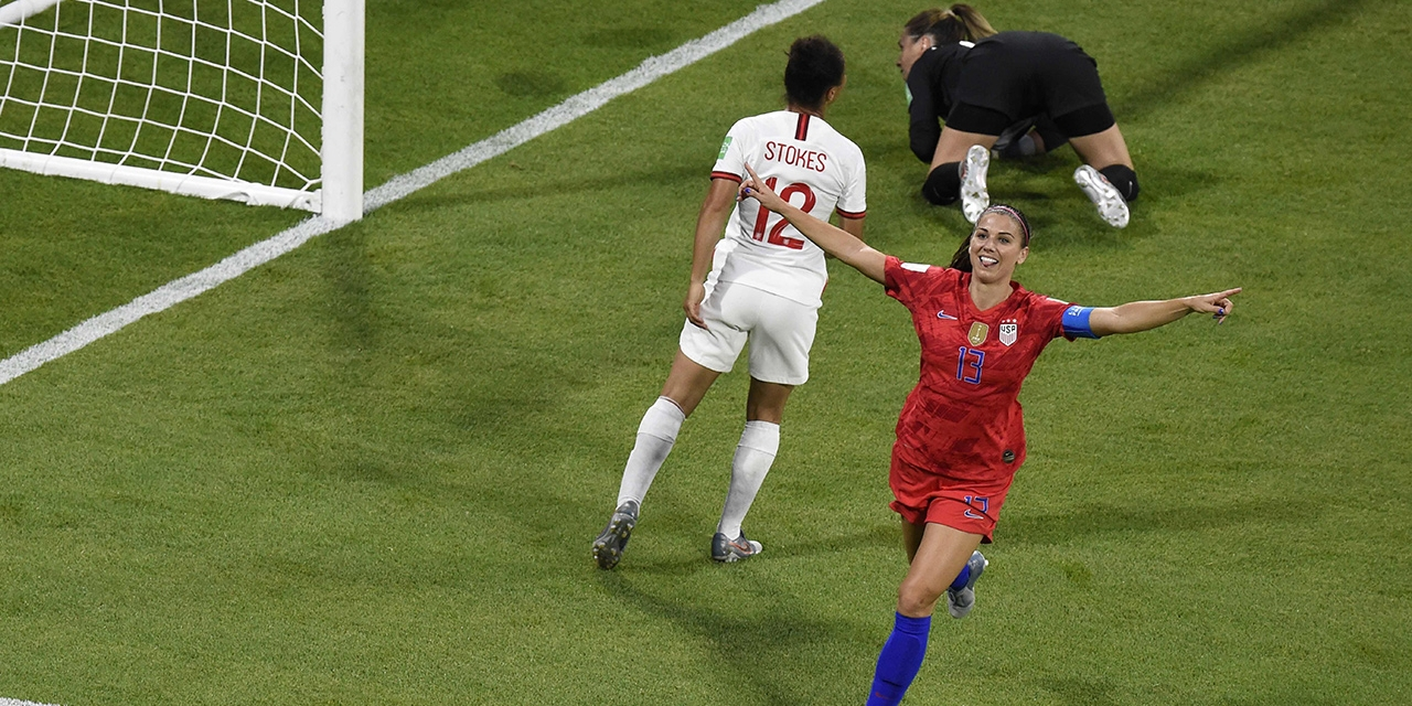 United States' forward Alex Morgan (C) celebrates after scoring a goal during the France 2019 Women's World Cup semi-final football match between England and USA