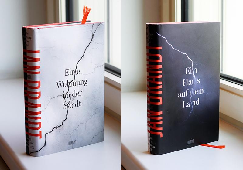 Buchcover mit zwei kopfüberstehenden Motiven: Blitz und Riss