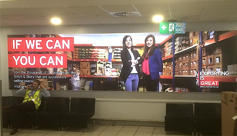 "Plakat am City Airport: ""If We Can You Can - Exporting is GREAT"""