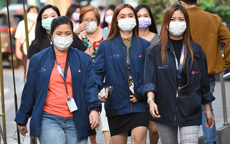 Büroangestellte in Manila: Auch auf den Philippinen ist am 30.1. ein Krankheitsfall gemeldet worden.