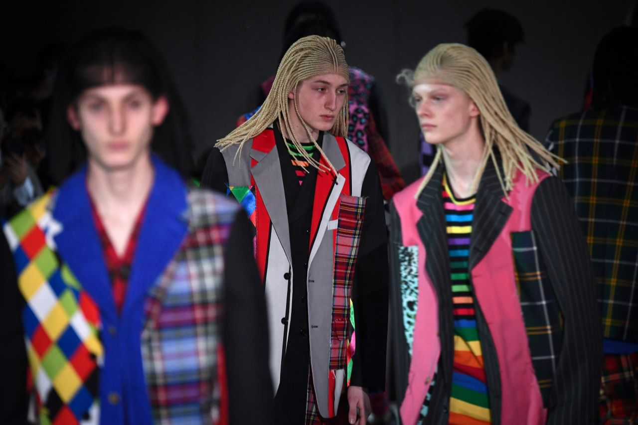 Models present creations by Comme Des Garçons, during the men's Fall/Winter 2020/2021 collection fashion show in Paris on January 17, 2020