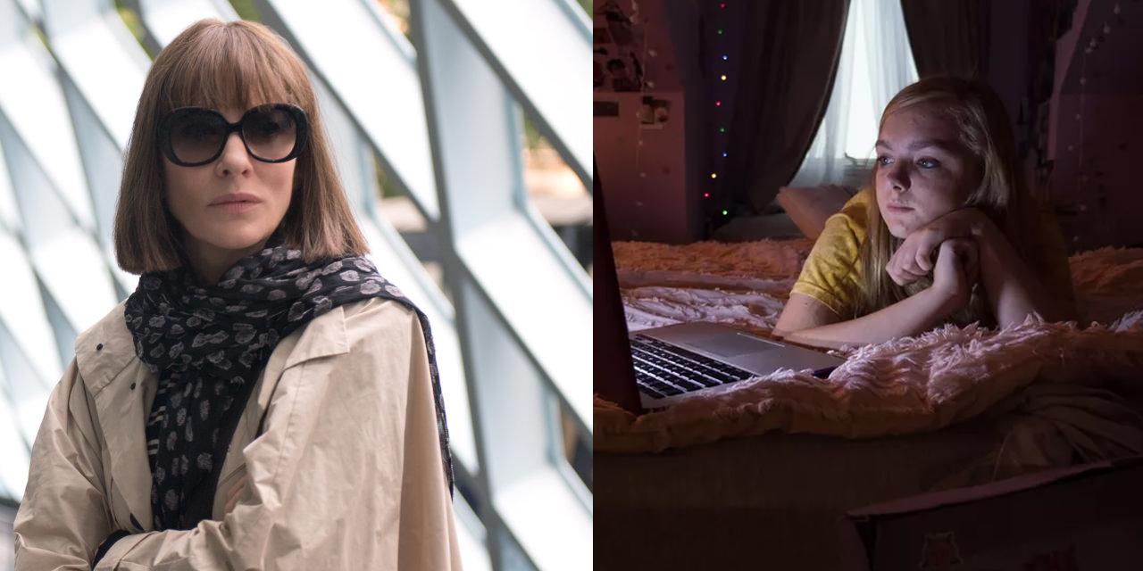 Frau mit Sonnenbrille und Mädchen vor seinem Computer