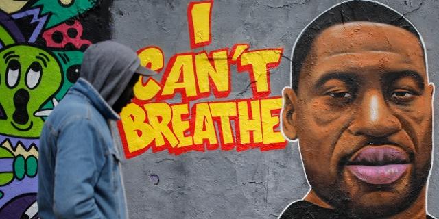 Grafitto mit dem Bild George Floyds