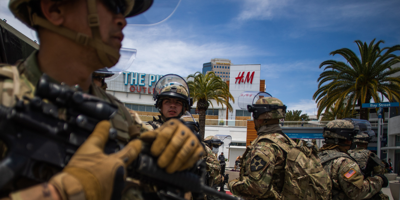US National Guards are seen in front of a shopping mall in Downtown Long Beach, California on June 1, 2020