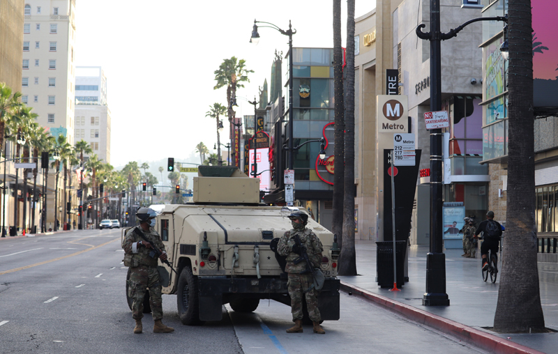 National Guards and armored trucks are patrolling Hollywood boulevard on May 31