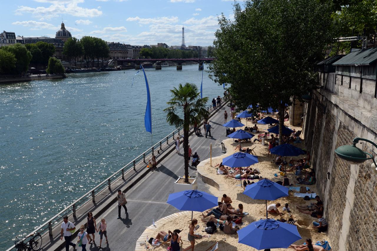 People sunbathe on the Seine river banks