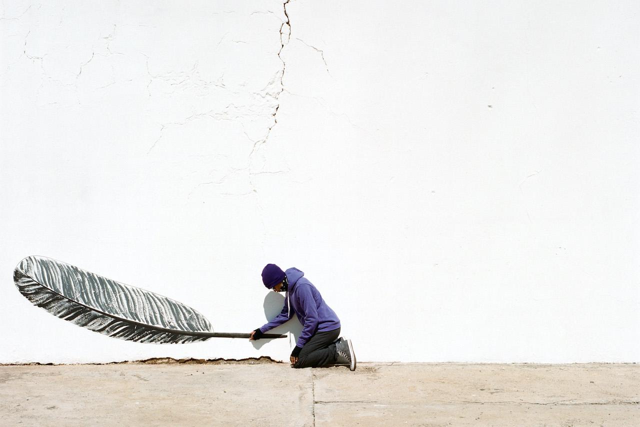 Robin Rhode Fotoprojekte: Menschen interagieren mit Wandmalereien