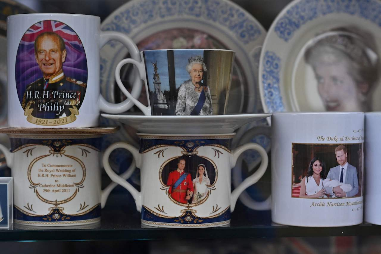 Royal memorabilia is displayed in a shop window in Windsor, west of London, on April 16, 2021, following the April 9 death of Britain's Prince Philip, Duke of Edinburgh, at the age of 99.