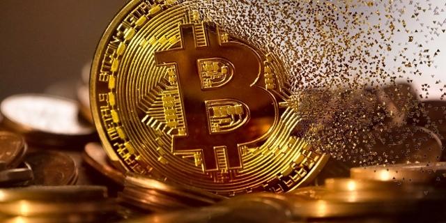 Bitcoin Goldmünze setzt sich aus vielen kleinen Teilchen zusammen