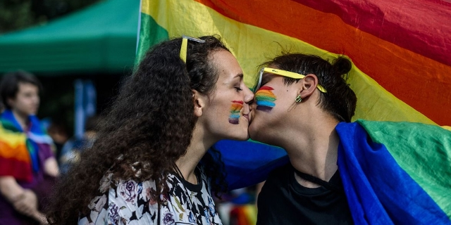 A couple kisses during the 11th Gay Pride Parade in downtown Sofia on June 9, 2018