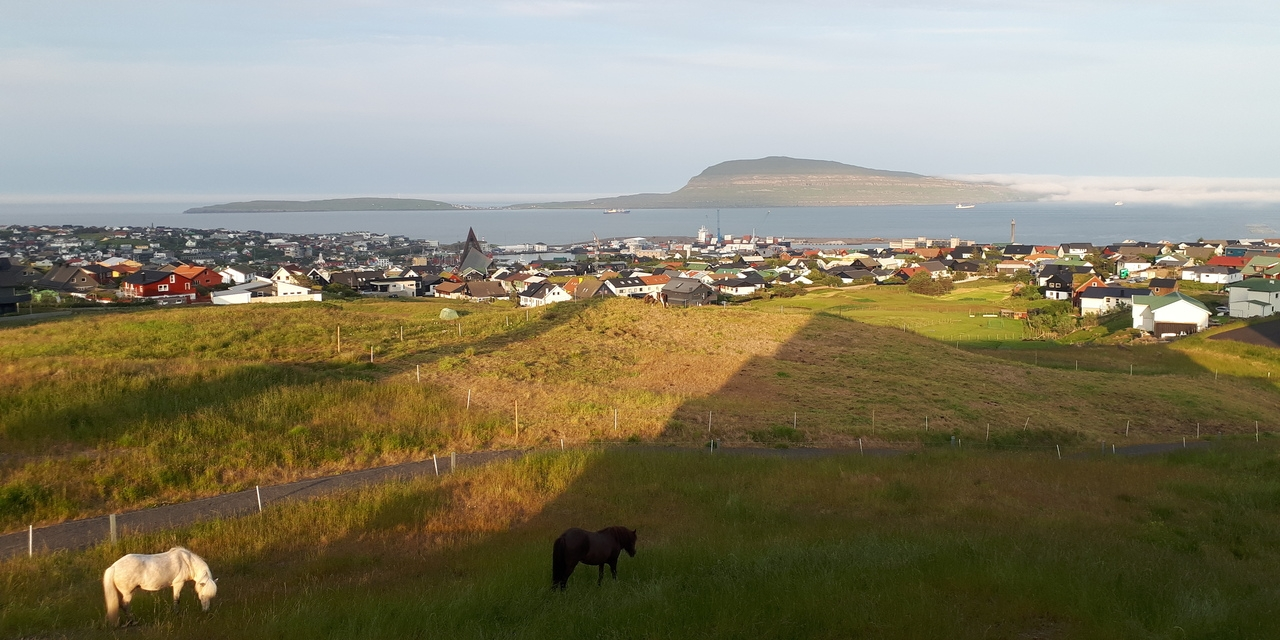 Beautiful sunset over Tórshavn, as seen from my room at 62°N Guesthouse Marknagil!