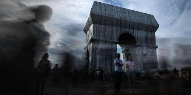 Arc de Triomphe, wrapped in silver-blue fabric, as it was designed by late artist Christo, in Paris as part of the 38th European Heritage Days